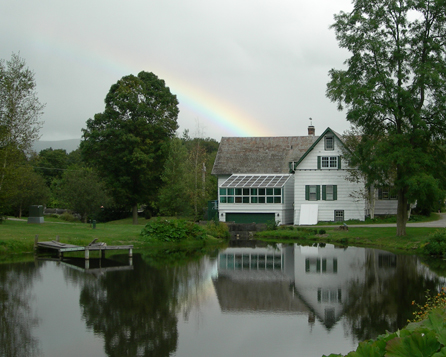 Taraden's main building with a naturally occurring rainbow above it.